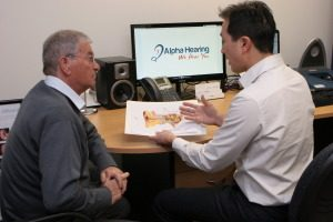 Audiologist Michael Wong with patient