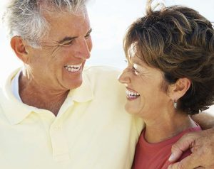 couple with hearing aids