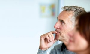 man listening with hearing aid