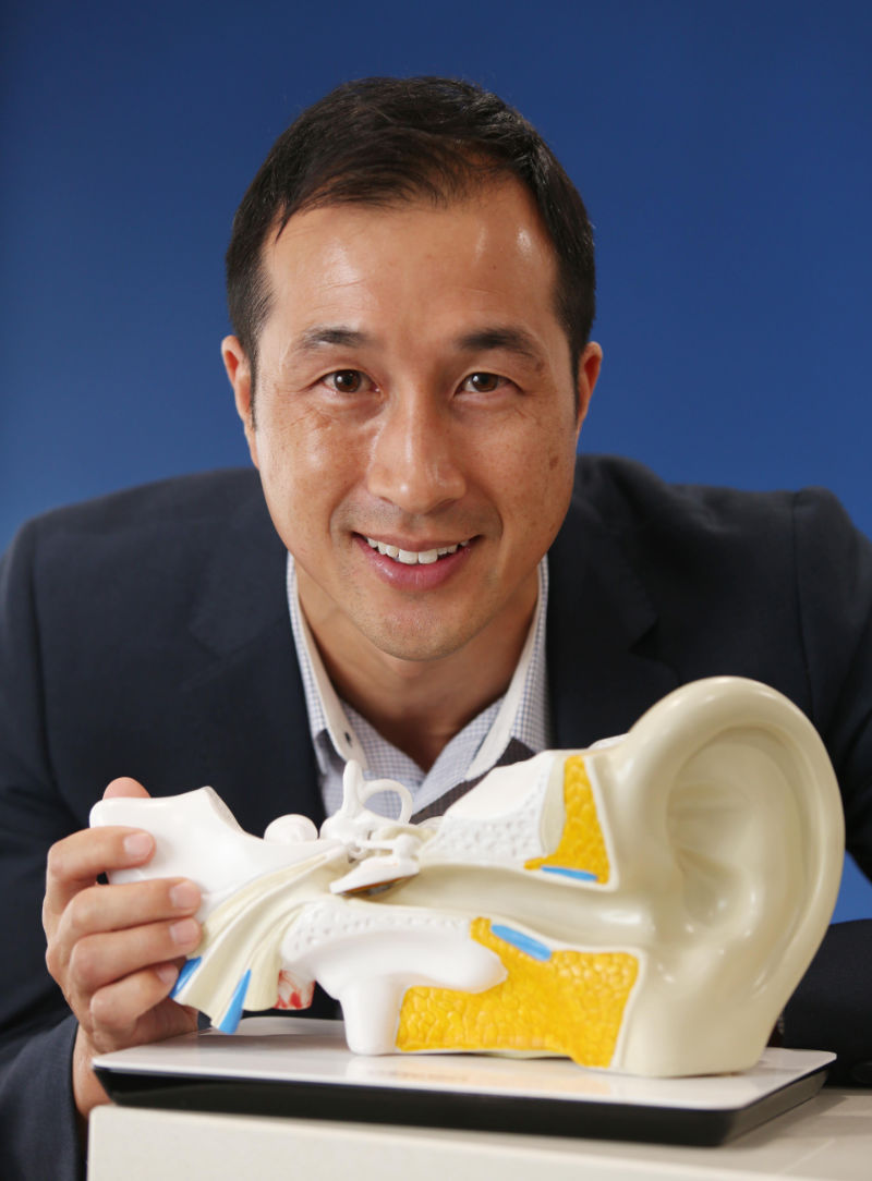 Michael Wong audiologist with ear model