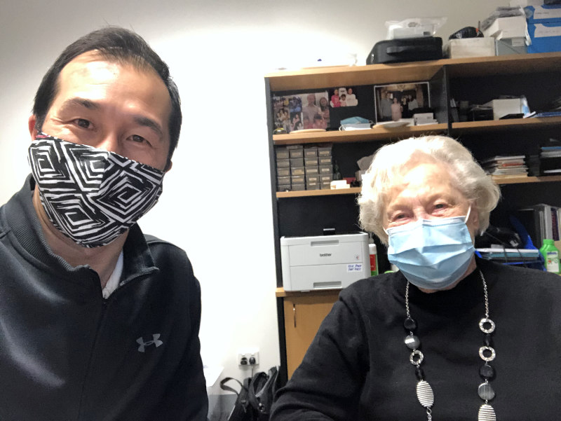 Smiling while wearing face mask