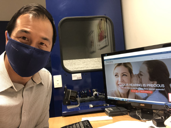 wearing face mask Michael Wong Clinic